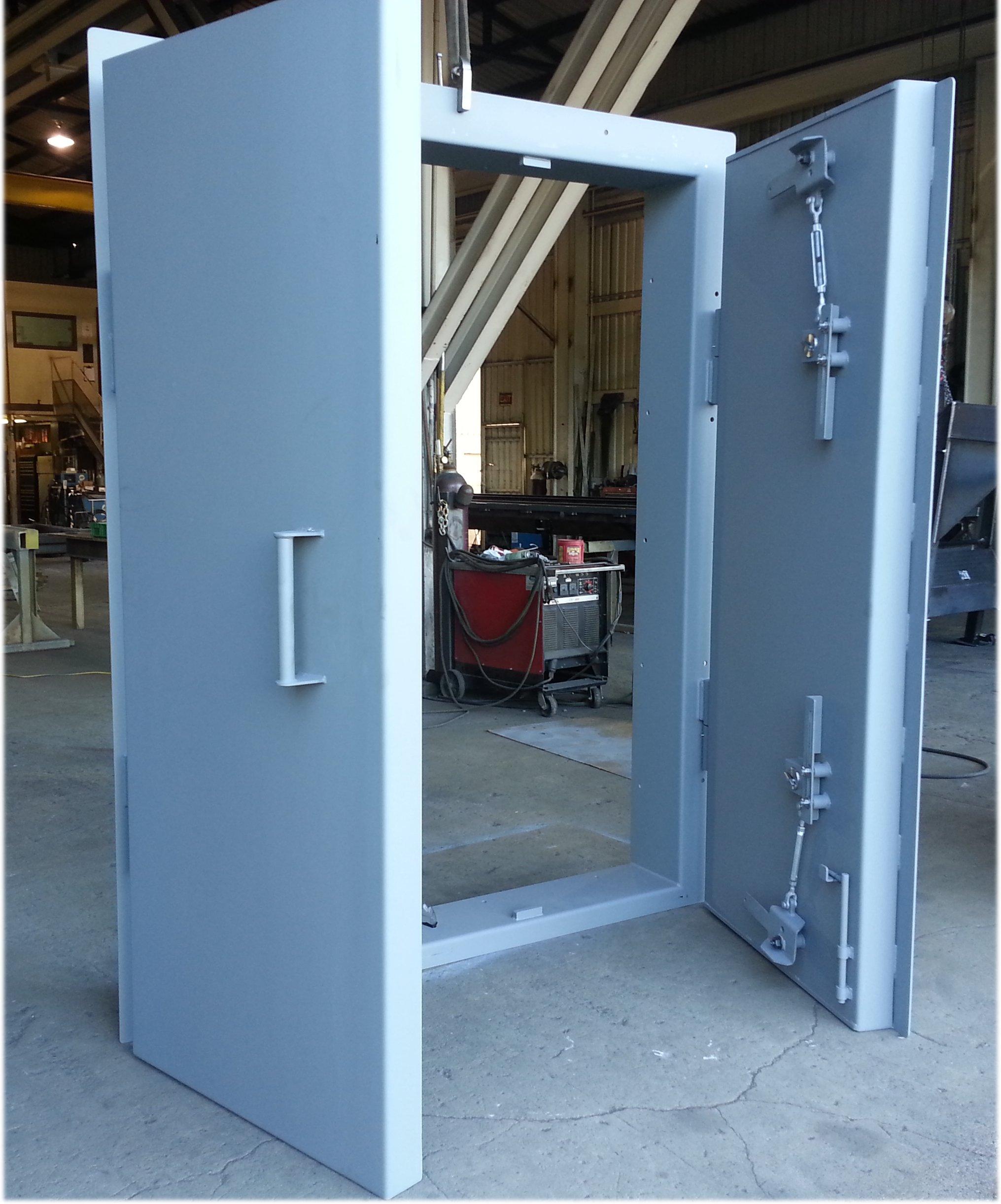Double leaf sliding ballistic door