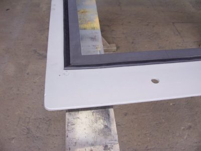 Compression seal on a blast door