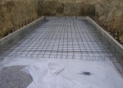 The plastic earth barrier and floor rebar are being installed